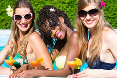 friend-drinking-cocktails-swimming-pool-bar-three-women-friends-african-caucasian-girls-66242320